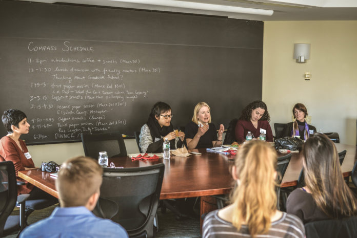 Faculty mentors (Ruth Chang, Sarah McGrath, Elizabeth Harman and L.A. Paul) sitting at a conference table discussing the pros and cons of graduate school to an audience of undergraduates.
